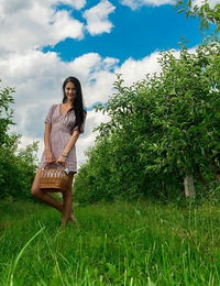 Katya enjoys an outdoor picnic in the orchard and a naughty outdoor masturbation.