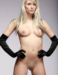 Nicole,Sexual Elegance,Nicole poses with picture perfect elegance wearing nothing but a pair of black satin gloves.