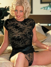 Andrea Trinity raises up her tight black mini-skirt